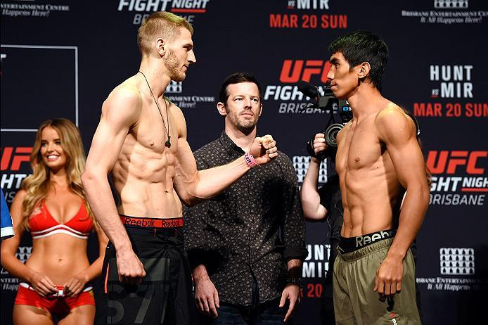 BRISBANE, AUSTRALIA - MARCH 19:  (L-R) Opponents Dan Hooker of New Zealand and Mark Eddiva of the Philippines face off during the UFC Fight Night weigh-in at the Brisbane Entertainment Centre on March 19, 2016 in Brisbane, Australia. (Photo by Josh Hedges