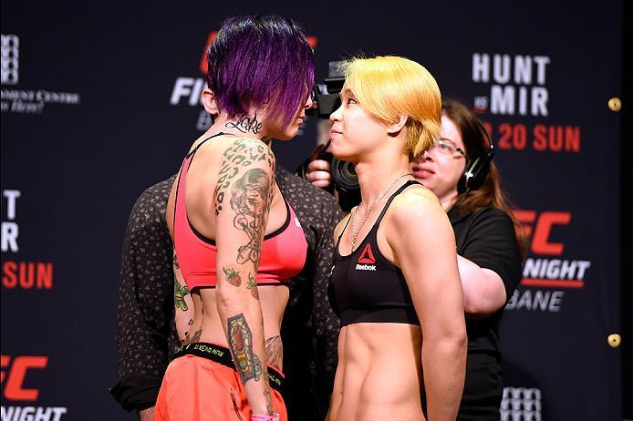 BRISBANE, AUSTRALIA - MARCH 19:  (L-R) Opponents Bec Rawlings of Australia and Seohee Ham of South Korea face off during the UFC Fight Night weigh-in at the Brisbane Entertainment Centre on March 19, 2016 in Brisbane, Australia. (Photo by Josh Hedges/Zuff