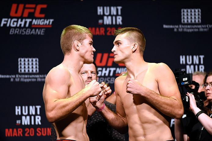 BRISBANE, AUSTRALIA - MARCH 19:   (L-R) Opponents Jake Matthews of Australia and Johnny Case face off during the UFC Fight Night weigh-in at the Brisbane Entertainment Centre on March 19, 2016 in Brisbane, Australia. (Photo by Josh Hedges/Zuffa LLC/Zuffa