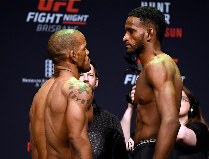 BRISBANE, AUSTRALIA - MARCH 19:   (L-R) Opponents Hector Lombard of Cuba and Neil Magny face off during the UFC Fight Night weigh-in at the Brisbane Entertainment Centre on March 19, 2016 in Brisbane, Australia. (Photo by Josh Hedges/Zuffa LLC/Zuffa LLC v