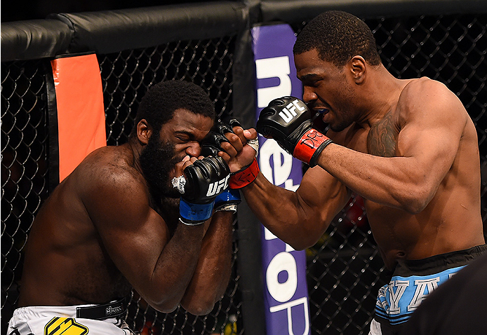 FAIRFAX, VA - APRIL 04:   (R-L) Ron Stallings punches Justin Jones in their middleweight fight during the UFC Fight Night event at the Patriot Center on April 4, 2015 in Fairfax, Virginia. (Photo by Josh Hedges/Zuffa LLC/Zuffa LLC via Getty Images)
