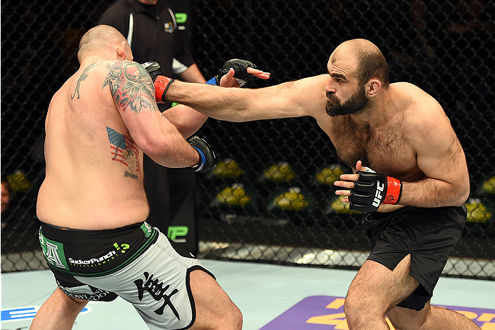 FAIRFAX, VA - APRIL 04:   (R-L) Shamil Abdurakhimov of Russia punches Timothy Johnson in their heavyweight fight during the UFC Fight Night event at the Patriot Center on April 4, 2015 in Fairfax, Virginia. (Photo by Josh Hedges/Zuffa LLC/Zuffa LLC via Ge