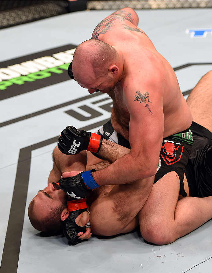 FAIRFAX, VA - APRIL 04:   (R-L) Timothy Johnson punches Shamil Abdurakhimov of Russia in their heavyweight fight during the UFC Fight Night event at the Patriot Center on April 4, 2015 in Fairfax, Virginia. (Photo by Josh Hedges/Zuffa LLC/Zuffa LLC via Ge