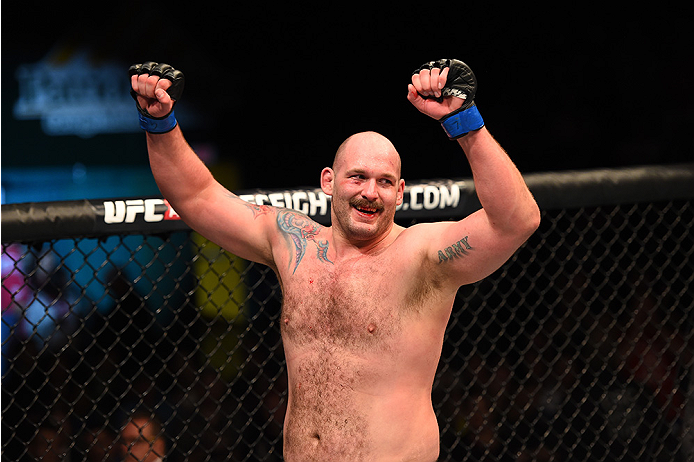 FAIRFAX, VA - APRIL 04:  Timothy Johnson celebrates after defeating Shamil Abdurakhimov of Russia in their heavyweight fight during the UFC Fight Night event at the Patriot Center on April 4, 2015 in Fairfax, Virginia. (Photo by Josh Hedges/Zuffa LLC/Zuff