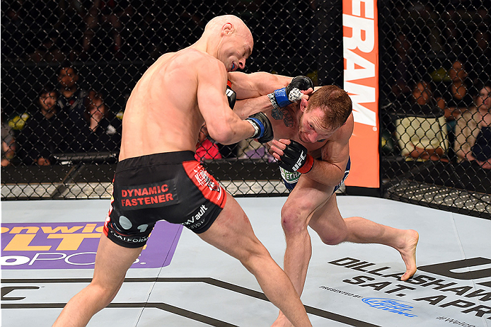 FAIRFAX, VA - APRIL 04:  (R-L) Gray Maynard punches Alexander Yakovlev in their lightweight fight during the UFC Fight Night event at the Patriot Center on April 4, 2015 in Fairfax, Virginia. (Photo by Josh Hedges/Zuffa LLC/Zuffa LLC via Getty Images)