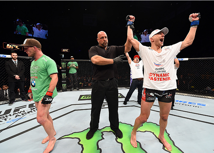 FAIRFAX, VA - APRIL 04:   (R-L) Alexander Yakovlev celebrates after defeating Gray Maynard in their lightweight fight during the UFC Fight Night event at the Patriot Center on April 4, 2015 in Fairfax, Virginia. (Photo by Josh Hedges/Zuffa LLC/Zuffa LLC v
