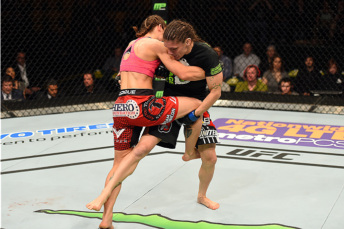 FAIRFAX, VA - APRIL 04:   (R-L) Lauren Murphy attempts a takedown against Liz Carmouche in their women's bantamweight fight during the UFC Fight Night event at the Patriot Center on April 4, 2015 in Fairfax, Virginia. (Photo by Josh Hedges/Zuffa LLC/Zuffa