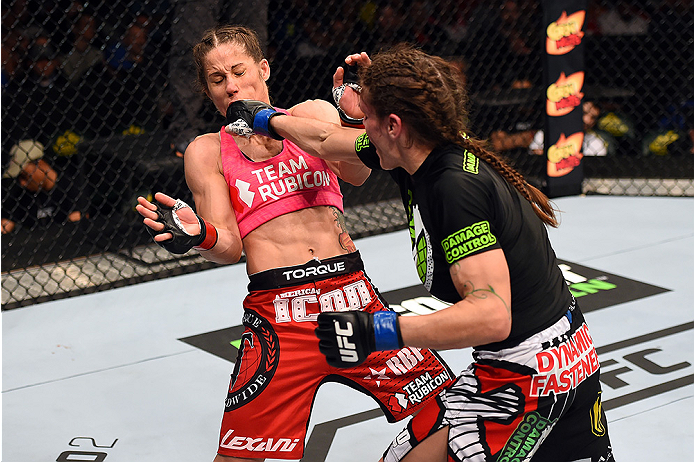 FAIRFAX, VA - APRIL 04:   (R-L) Lauren Murphy punches Liz Carmouche in their women's bantamweight fight during the UFC Fight Night event at the Patriot Center on April 4, 2015 in Fairfax, Virginia. (Photo by Josh Hedges/Zuffa LLC/Zuffa LLC via Getty Image