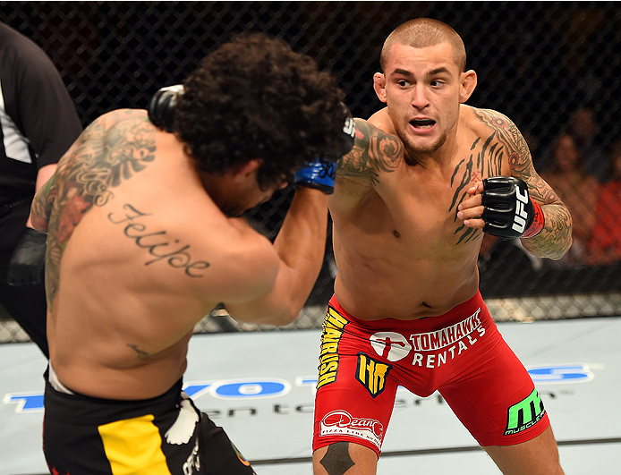 FAIRFAX, VA - APRIL 04:   (R-L) Dustin Poirier punches Diego Ferreira in their lightweight fight during the UFC Fight Night event at the Patriot Center on April 4, 2015 in Fairfax, Virginia. (Photo by Josh Hedges/Zuffa LLC/Zuffa LLC via Getty Images)