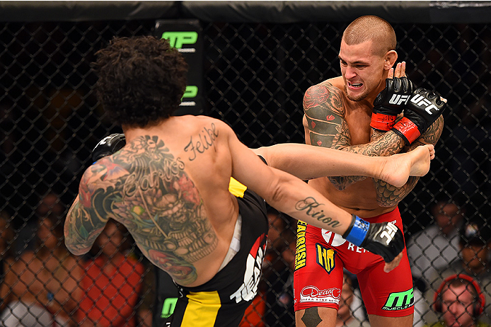 FAIRFAX, VA - APRIL 04:  (L-R) Diego Ferreira kicks Dustin Poirier in their lightweight fight during the UFC Fight Night event at the Patriot Center on April 4, 2015 in Fairfax, Virginia. (Photo by Josh Hedges/Zuffa LLC/Zuffa LLC via Getty Images)