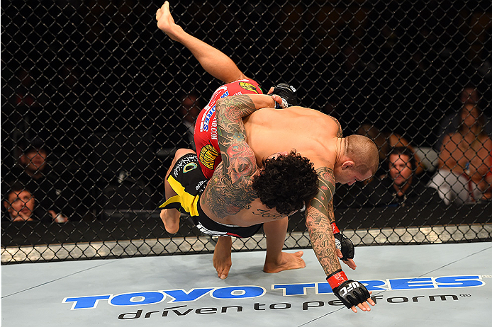 FAIRFAX, VA - APRIL 04:  (L-R) Diego Ferreira takes down Dustin Poirier in their lightweight fight during the UFC Fight Night event at the Patriot Center on April 4, 2015 in Fairfax, Virginia. (Photo by Josh Hedges/Zuffa LLC/Zuffa LLC via Getty Images)