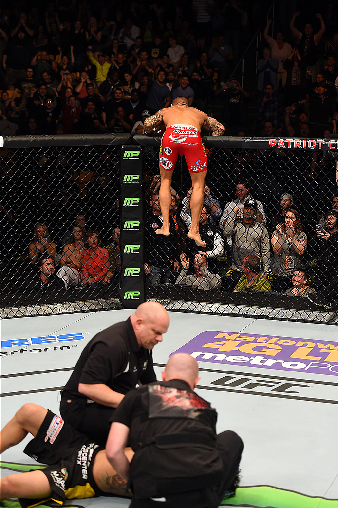 FAIRFAX, VA - APRIL 04:  Dustin Poirier (top) celebrates after knocking out Diego Ferreira in their lightweight fight during the UFC Fight Night event at the Patriot Center on April 4, 2015 in Fairfax, Virginia. (Photo by Josh Hedges/Zuffa LLC/Zuffa LLC v