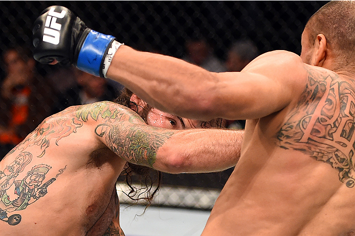 FAIRFAX, VA - APRIL 04:  (L-R) Clay Guida punches Robbie Peralta in their featherweight fight during the UFC Fight Night event at the Patriot Center on April 4, 2015 in Fairfax, Virginia. (Photo by Josh Hedges/Zuffa LLC/Zuffa LLC via Getty Images)