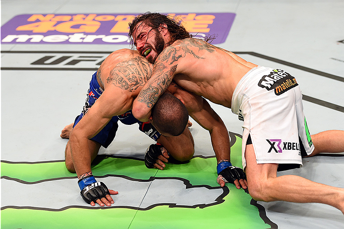 FAIRFAX, VA - APRIL 04:  (R-L) Clay Guida attempts to submit Robbie Peralta in their featherweight fight during the UFC Fight Night event at the Patriot Center on April 4, 2015 in Fairfax, Virginia. (Photo by Josh Hedges/Zuffa LLC/Zuffa LLC via Getty Imag