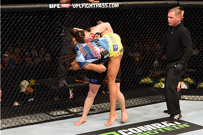 FAIRFAX, VA - APRIL 04:  (L-R) Milana Dudieva attempts to take down Juliana Pena in their women's bantamweight fight during the UFC Fight Night event at the Patriot Center on April 4, 2015 in Fairfax, Virginia. (Photo by Josh Hedges/Zuffa LLC/Zuffa LLC vi