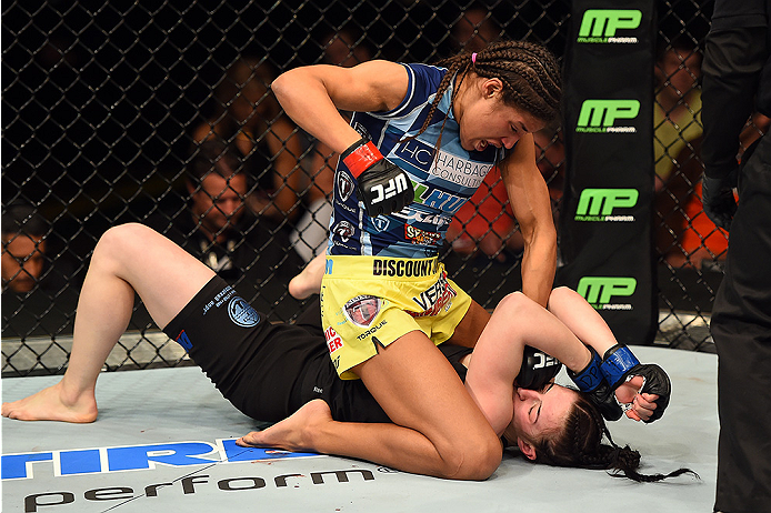 FAIRFAX, VA - APRIL 04:  (L-R) Juliana Pena punches Milana Dudieva on the ground in their women's bantamweight fight during the UFC Fight Night event at the Patriot Center on April 4, 2015 in Fairfax, Virginia. (Photo by Josh Hedges/Zuffa LLC/Zuffa LLC vi