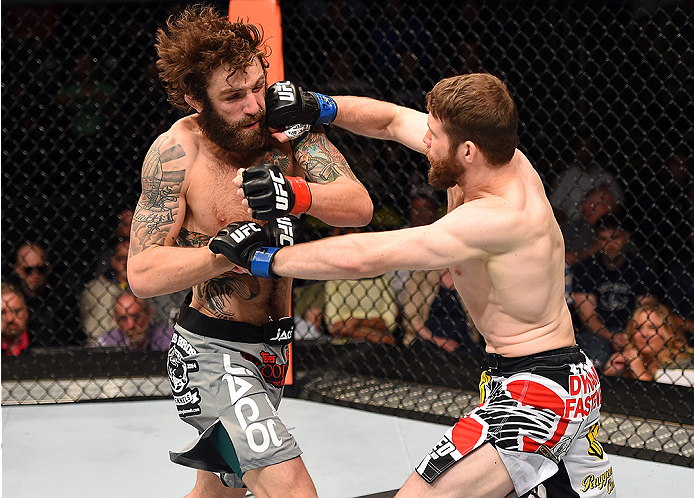 FAIRFAX, VA - APRIL 04:  (R-L) Mitch Clarke punches Michael Chiesa in their lightweight fight during the UFC Fight Night event at the Patriot Center on April 4, 2015 in Fairfax, Virginia. (Photo by Josh Hedges/Zuffa LLC/Zuffa LLC via Getty Images)