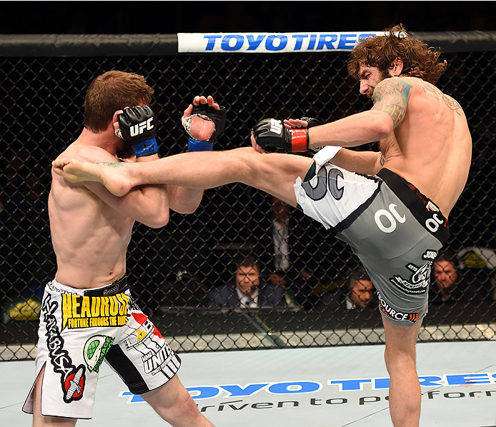 FAIRFAX, VA - APRIL 04:  (R-L) Michael Chiesa kicks Mitch Clarke in their lightweight fight during the UFC Fight Night event at the Patriot Center on April 4, 2015 in Fairfax, Virginia. (Photo by Josh Hedges/Zuffa LLC/Zuffa LLC via Getty Images)