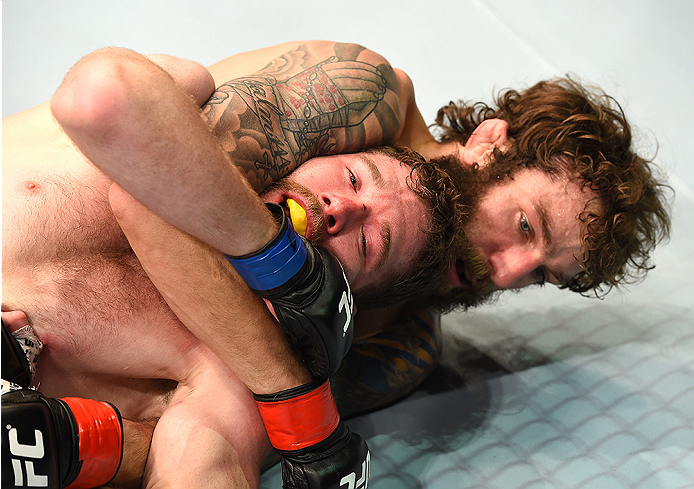 FAIRFAX, VA - APRIL 04:  (R-L) Michael Chiesa attempts a submission against Mitch Clarke in their lightweight fight during the UFC Fight Night event at the Patriot Center on April 4, 2015 in Fairfax, Virginia. (Photo by Josh Hedges/Zuffa LLC/Zuffa LLC via