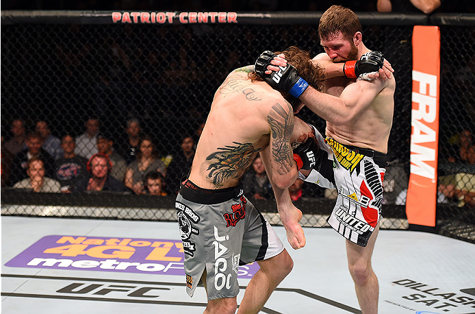 FAIRFAX, VA - APRIL 04:  (R-L) Mitch Clarke lands a knee to Michael Chiesa in their lightweight fight during the UFC Fight Night event at the Patriot Center on April 4, 2015 in Fairfax, Virginia. (Photo by Josh Hedges/Zuffa LLC/Zuffa LLC via Getty Images)