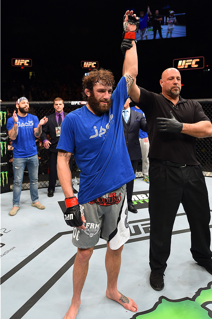 FAIRFAX, VA - APRIL 04:  Michael Chiesa celebrates after defeating Mitch Clarke in their lightweight fight during the UFC Fight Night event at the Patriot Center on April 4, 2015 in Fairfax, Virginia. (Photo by Josh Hedges/Zuffa LLC/Zuffa LLC via Getty Im