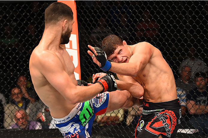 FAIRFAX, VA - APRIL 04:  (L-R) Jorge Masvidal lands a kick against Al Iaquinta in their lightweight fight during the UFC Fight Night event at the Patriot Center on April 4, 2015 in Fairfax, Virginia. (Photo by Josh Hedges/Zuffa LLC/Zuffa LLC via Getty Ima