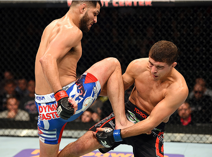 FAIRFAX, VA - APRIL 04:  (L-R) Jorge Masvidal throws a flying knee against Al Iaquinta in their lightweight fight during the UFC Fight Night event at the Patriot Center on April 4, 2015 in Fairfax, Virginia. (Photo by Josh Hedges/Zuffa LLC/Zuffa LLC via G