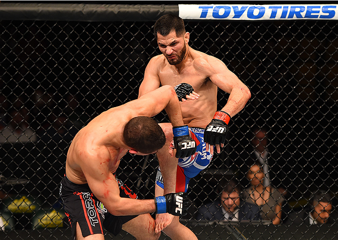 FAIRFAX, VA - APRIL 04:  (R-L) Jorge Masvidal lands a knee to the head of Al Iaquinta in their lightweight fight during the UFC Fight Night event at the Patriot Center on April 4, 2015 in Fairfax, Virginia. (Photo by Josh Hedges/Zuffa LLC/Zuffa LLC via Ge