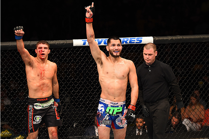 FAIRFAX, VA - APRIL 04:  (R-L) Jorge Masvidal and Al Iaquinta react immediately following their lightweight fight during the UFC Fight Night event at the Patriot Center on April 4, 2015 in Fairfax, Virginia. (Photo by Josh Hedges/Zuffa LLC/Zuffa LLC via G