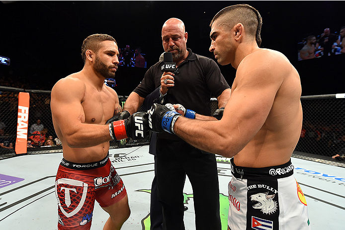 FAIRFAX, VA - APRIL 04:   (L-R) Chad Mendes and Ricardo Lamas touch gloves before in their featherweight fight during the UFC Fight Night event at the Patriot Center on April 4, 2015 in Fairfax, Virginia. (Photo by Josh Hedges/Zuffa LLC/Zuffa LLC via Gett