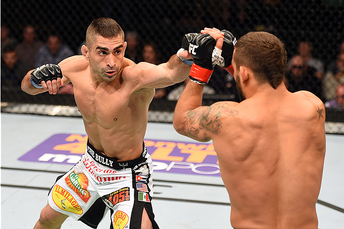 FAIRFAX, VA - APRIL 04:  (L-R) Ricardo Lamas throw a punch against Chad Mendes in their featherweight fight during the UFC Fight Night event at the Patriot Center on April 4, 2015 in Fairfax, Virginia. (Photo by Josh Hedges/Zuffa LLC/Zuffa LLC via Getty I