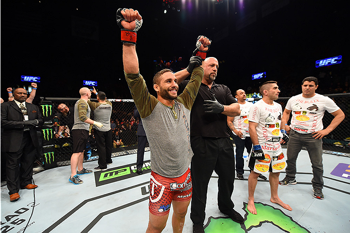 FAIRFAX, VA - APRIL 04:  (L-R) Chad Mendes celebrates after defeating Ricardo Lamas in their featherweight fight during the UFC Fight Night event at the Patriot Center on April 4, 2015 in Fairfax, Virginia. (Photo by Josh Hedges/Zuffa LLC/Zuffa LLC via Ge