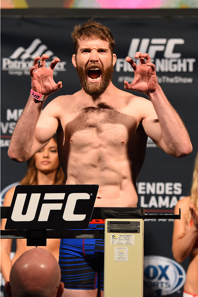 FAIRFAX, VA - APRIL 03:   Mitch Clarke of Canada weighs in during the UFC weigh-in at the Patriot Center on April 3, 2015 in Fairfax, Virginia. (Photo by Josh Hedges/Zuffa LLC/Zuffa LLC via Getty Images)