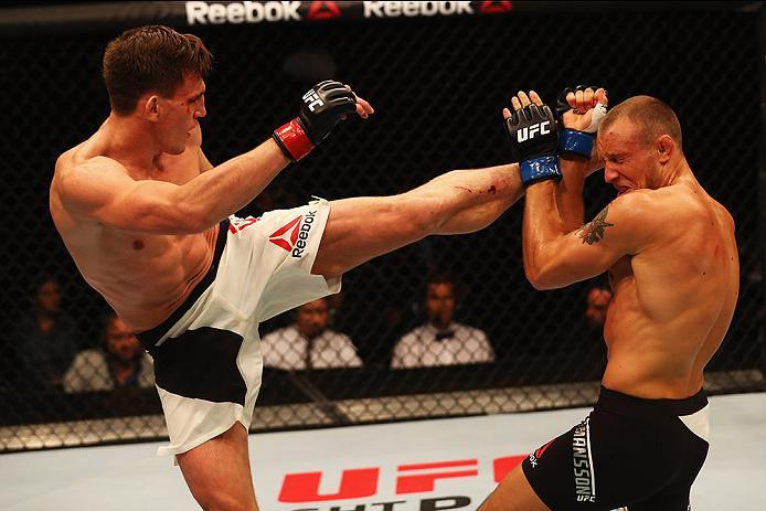 HAMBURG, GERMANY - SEPTEMBER 03:  Scott Askham (L) of England kicks facing Jack Hermansson (R) of Sweden in their Middleweight Bout during the UFC Fight Night held at Barclaycard Arena on September 3, 2016 in Hamburg, Germany.  (Photo by Dean Mouhtaropoul