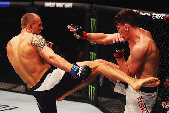 HAMBURG, GERMANY - SEPTEMBER 03:  Jack Hermansson (L) of Sweden kicks Scott Askham (R) of England  in their Middleweight Bout during the UFC Fight Night held at Barclaycard Arena on September 3, 2016 in Hamburg, Germany.  (Photo by Dean Mouhtaropoulos/Zuf