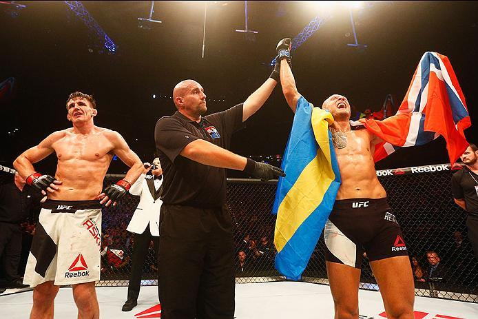 HAMBURG, GERMANY - SEPTEMBER 03:  Jack Hermansson (R) of Sweden celebrates his victory over Scott Askham (L) of England compete in their Middleweight Bout during the UFC Fight Night held at Barclaycard Arena on September 3, 2016 in Hamburg, Germany.  (Pho