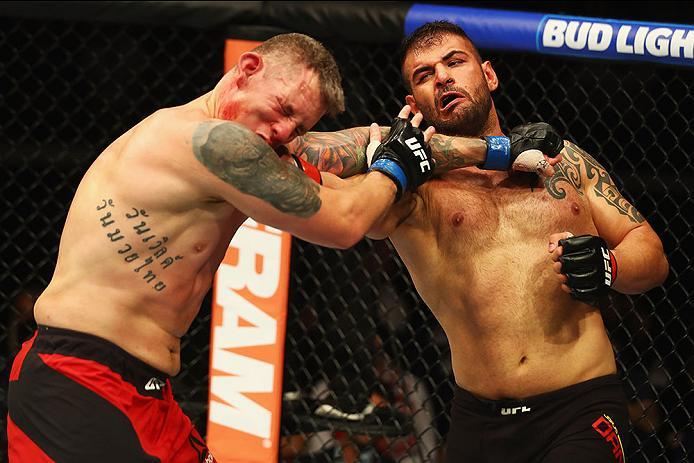 HAMBURG, GERMANY - SEPTEMBER 03:   Jarjis Danho (R) of Syria punches Christian Colombo (L) of Denmark in their Heavyweight Bout during the UFC Fight Night held at Barclaycard Arena on September 3, 2016 in Hamburg, Germany.  (Photo by Dean Mouhtaropoulos/Z