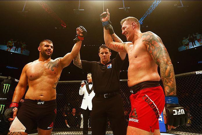 HAMBURG, GERMANY - SEPTEMBER 03:  Christian Colombo (R) of Denmark celebrates victory over Jarjis Danho (L) of Syria compete in their Heavyweight Bout during the UFC Fight Night held at Barclaycard Arena on September 3, 2016 in Hamburg, Germany.  (Photo b