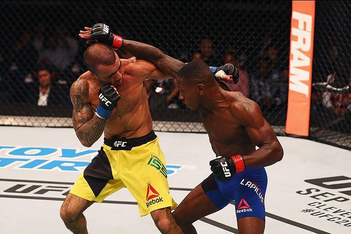 HAMBURG, GERMANY - SEPTEMBER 03:  Taylor Lapilus (R) of France punches Leandro Issa (L) of Brazil  in their Bantamweight Bout during the UFC Fight Night held at Barclaycard Arena on September 3, 2016 in Hamburg, Germany.  (Photo by Dean Mouhtaropoulos/Zuf