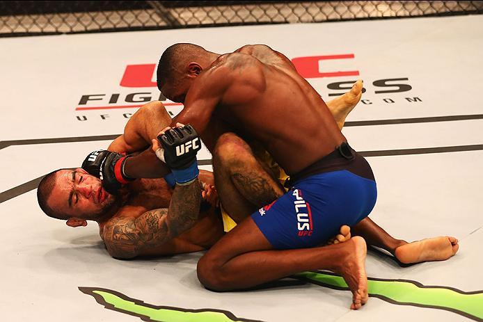 HAMBURG, GERMANY - SEPTEMBER 03:  Taylor Lapilus (top) of France controls the body of Leandro Issa (L) of Brazil  in their Bantamweight Bout during the UFC Fight Night held at Barclaycard Arena on September 3, 2016 in Hamburg, Germany.  (Photo by Dean Mou