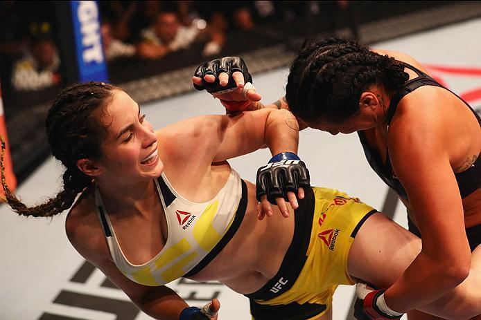 HAMBURG, GERMANY - SEPTEMBER 03:  Veronica Macedo (L) of Venezuela kicks facing Ashlee Evans-Smith (R) of the USA compete in their Womens Bantamweight Bout during the UFC Fight Night held at Barclaycard Arena on September 3, 2016 in Hamburg, Germany.  (Ph