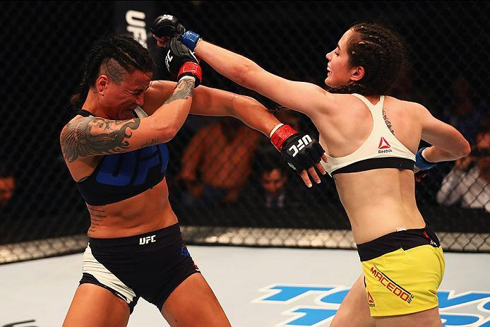 HAMBURG, GERMANY - SEPTEMBER 03:  Veronica Macedo (R) of Venezuela punches Ashlee Evans-Smith (L) of the USA compete in their Womens Bantamweight Bout during the UFC Fight Night held at Barclaycard Arena on September 3, 2016 in Hamburg, Germany.  (Photo b
