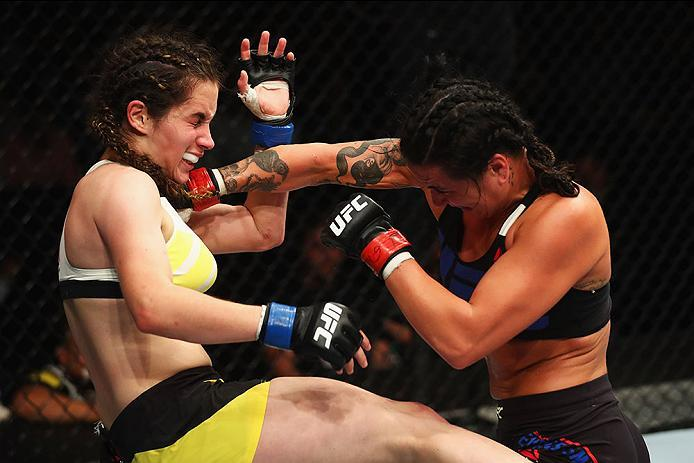 HAMBURG, GERMANY - SEPTEMBER 03:  Ashlee Evans-Smith (R) of the USA punches Veronica Macedo (L) of Venezuela in their Womens Bantamweight Bout during the UFC Fight Night held at Barclaycard Arena on September 3, 2016 in Hamburg, Germany.  (Photo by Dean M