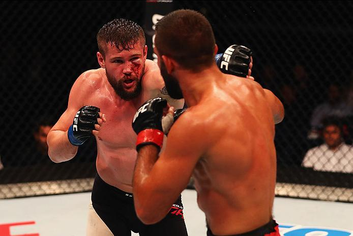 HAMBURG, GERMANY - SEPTEMBER 03:  Nicolas Dalby (L) of Denmark punches Peter Sobotta (R) of Poland and Germany compete in their Welterweight Bout during the UFC Fight Night held at Barclaycard Arena on September 3, 2016 in Hamburg, Germany.  (Photo by Dea