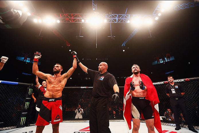 HAMBURG, GERMANY - SEPTEMBER 03:   Peter Sobotta (L) of Poland celebrates his victory of Nicolas Dalby (R) of Denmark after in their Welterweight Bout during the UFC Fight Night held at Barclaycard Arena on September 3, 2016 in Hamburg, Germany.  (Photo b