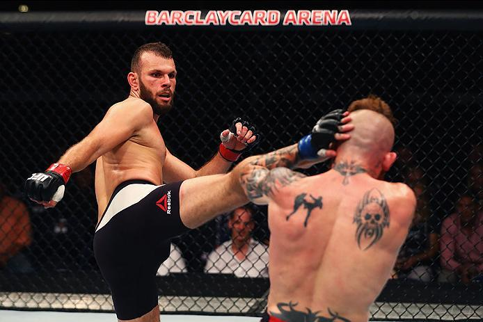 HAMBURG, GERMANY - SEPTEMBER 03:  Jessin Ayari (L) of Germany kicks facing Jim Wallhead (R) of England and compete in their Welterweight Bout during the UFC Fight Night held at Barclaycard Arena on September 3, 2016 in Hamburg, Germany.  (Photo by Dean Mo