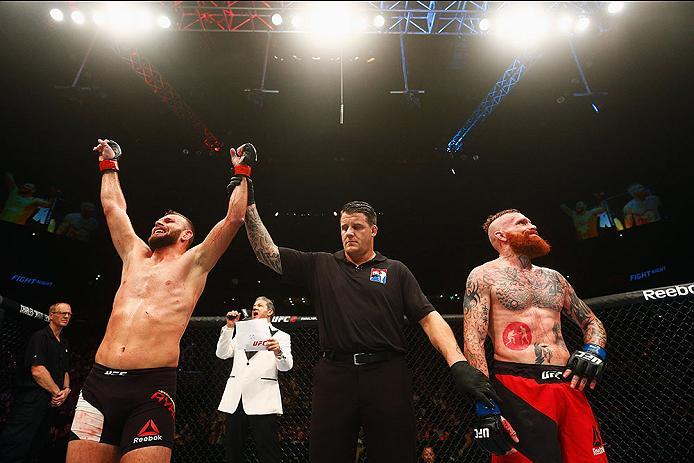 HAMBURG, GERMANY - SEPTEMBER 03:  Jessin Ayari (L) of Germany celebrates his victory overJim Wallhead (R) of England and  in their Welterweight Bout during the UFC Fight Night held at Barclaycard Arena on September 3, 2016 in Hamburg, Germany.  (Photo by