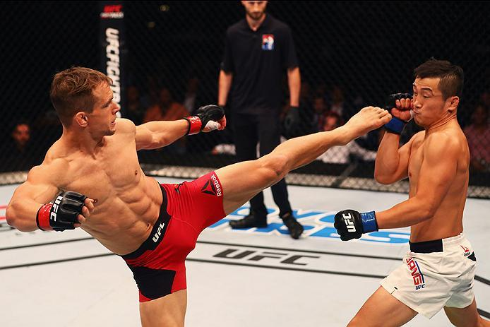 HAMBURG, GERMANY - SEPTEMBER 03:  Tae Hyun Bang (R) of South Korea and Nick Hein (L) of Germany compete in their Lightweight Bout during the UFC Fight Night held at Barclaycard Arena on September 3, 2016 in Hamburg, Germany.  (Photo by Dean Mouhtaropoulos
