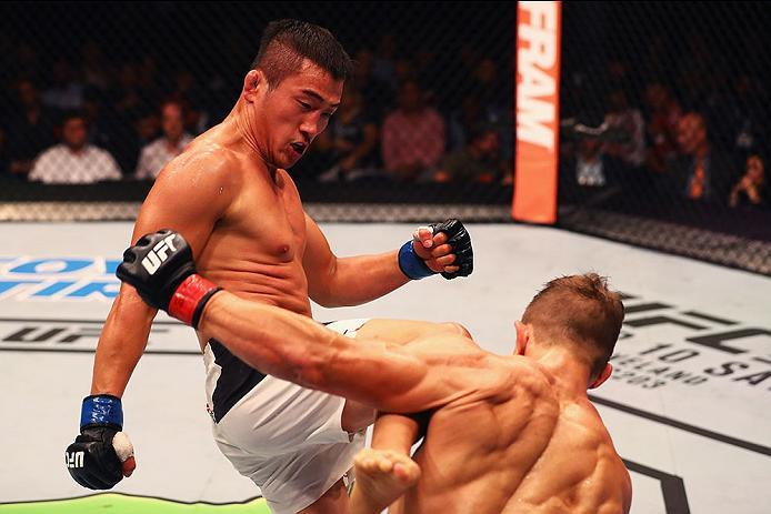HAMBURG, GERMANY - SEPTEMBER 03:  Tae Hyun Bang (L) of South Korea kicks facing Nick Hein (R) of Germany compete in their Lightweight Bout during the UFC Fight Night held at Barclaycard Arena on September 3, 2016 in Hamburg, Germany.  (Photo by Dean Mouht