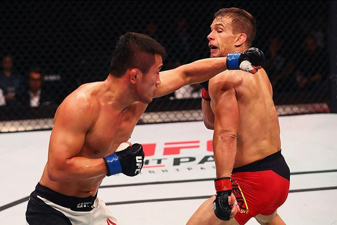 HAMBURG, GERMANY - SEPTEMBER 03:  Tae Hyun Bang (L) of South Korea punches Nick Hein (R) of Germany compete in their Lightweight Bout during the UFC Fight Night held at Barclaycard Arena on September 3, 2016 in Hamburg, Germany.  (Photo by Dean Mouhtaropo